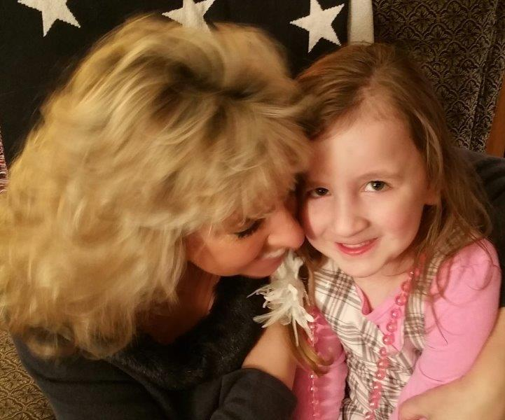 Chris Kellett hugging granddaughter Brainerd MN